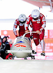 18 December 2010: Lyndon Rush starts up his 2-man bobsled for Canada, finishing in 5th place at the Viessmann FIBT World Cup Bobsled Championships on Mount Van Hoevenberg in Lake Placid, New York, USA. Mandatory Credit: Ed Wolfstein Photo