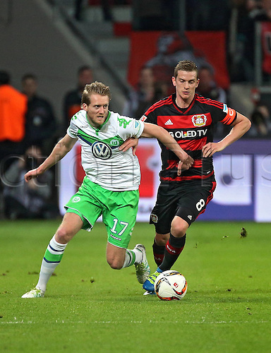 01.04.2016. Leverkusen, Germay. Bundesliga football. Bayer Leverkusen versus VFL Wolfsburg in the BayArena in Leverkusen.  Andre Schuerrle (VfL Wolfsburg), Lars Bender (Bayer 04 Leverkusen)