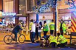 © Joel Goodman - 07973 332324 . 11/09/2016 . Manchester , UK . Taxi marshals help a woman , lying collapsed on the pavement on Withy Grove , as an ambulance arrives . Revellers out in Manchester City Centre . Photo credit : Joel Goodman