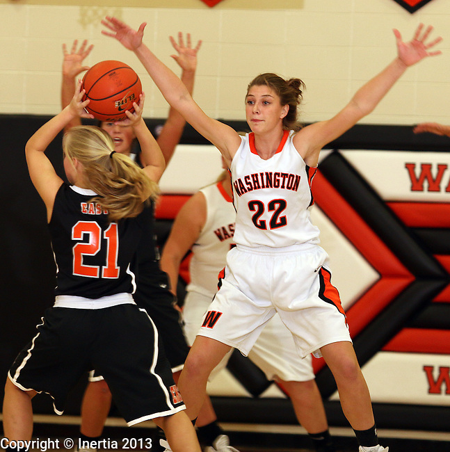 SIOUX FALLS, SD: DECEMBER 10: Anna Goodhope #22 from Washington applies pressure to Kylee Goodvin #21 from Sioux City East in the first quarter of their season opener Tuesday night at Washington. (photo by Dave Eggen/Inertia)