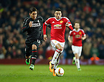 Roberto Firminho of Liverpool chases Jesse Lingard of Manchester United during the UEFA Europa League match at Old Trafford. Photo credit should read: Philip Oldham/Sportimage