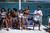 Natal, Brazil. Group of schoolgirls on a boat trip to a snorkelling island.