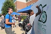 NWA Democrat-Gazette/FLIP PUTTHOFF<br /> GOAL SETTERS<br /> Nick Campbell (left) and Damerius Polk put in writing their goals for the semester on a poster during Student Welcome Week activties on Wednesday at Northwest Arkansas Community College. The event featured games, food, vendor exhibits and information about NWACC programs. The college's Student Ambassador and Activities Board organized the event. &quot;It's an opportunity for students to have fun and get acquainted with the college,&quot; said Becky Hudson, director of student life. Welcome festivities continue today at the college.
