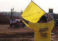 Dec. 10, 2010; Chandler, AZ, USA; A LOORRS flagman displays the yellow flag during qualifying for round 15 at Firebird International Raceway. Mandatory Credit: Mark J. Rebilas-US PRESSWIRE