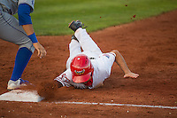 Michael Pierson (2) of the Orem Owlz dives back to the bag during the game against the Ogden Raptors in Pioneer League action at Home of the Owlz on June 20, 2015 in Provo, Utah.The Raptors defeated the Owlz 9-6.(Stephen Smith/Four Seam Images)