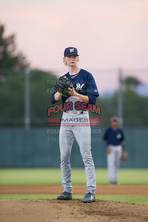 AZL Brewers starting pitcher Caden Lemons (18) looks to his catcher for the sign against the AZL Athletics on August 18, 2017 at Lew Wolff Training Complex in Mesa, Arizona. AZL Brewers defeated the AZL Athletics 6-4. (Zachary Lucy/Four Seam Images)
