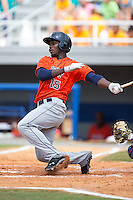 Hector Roa (15) of the Greeneville Astros follows through on his swing against the Kingsport Mets at Hunter Wright Stadium on July 7, 2015 in Kingsport, Tennessee.  The Mets defeated the Astros 6-4. (Brian Westerholt/Four Seam Images)