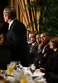 United States President Barack Obama and first lady Michelle Obama listen as Prime Minister Jose Luis Rodriguez Zapatero of Spain speaks at the 58th National Prayer Breakfast at the Washington Hilton Hotel, Washington, DC, Thursday, February 4, 2010..Credit: Martin H. Simon - Pool via CNP