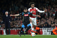 Elseid Hysaj of Napoli and Arsenal's Alex Iwobi challenge for the ball during Arsenal vs Napoli, UEFA Europa League Football at the Emirates Stadium on 11th April 2019