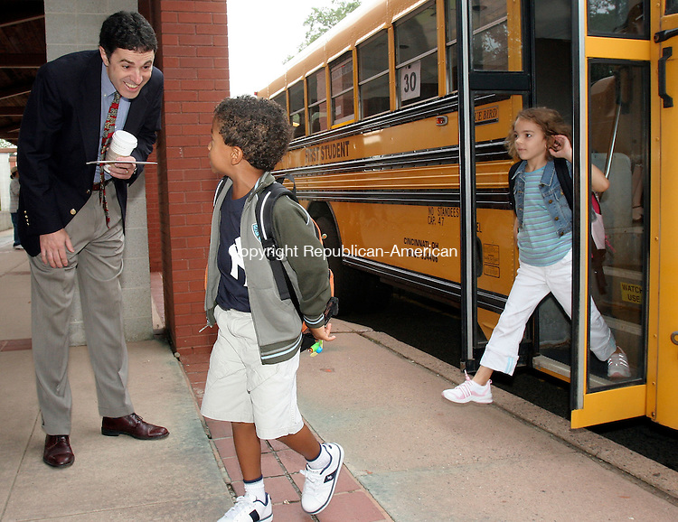 MIDDLEBURY, CT-31August 2006-083106TK06- (left to right) On the first day of school in Region 15, Middlebury Elementary School Principal Jack Zamary welcomes first graders Maxwell Baskins and Deanna Pietrorazio back to class after a long summer vacation.  Tom Kabelka Republican-American (Jack Zamary, Maxwell Baskins, Deanna Pietrorazio)