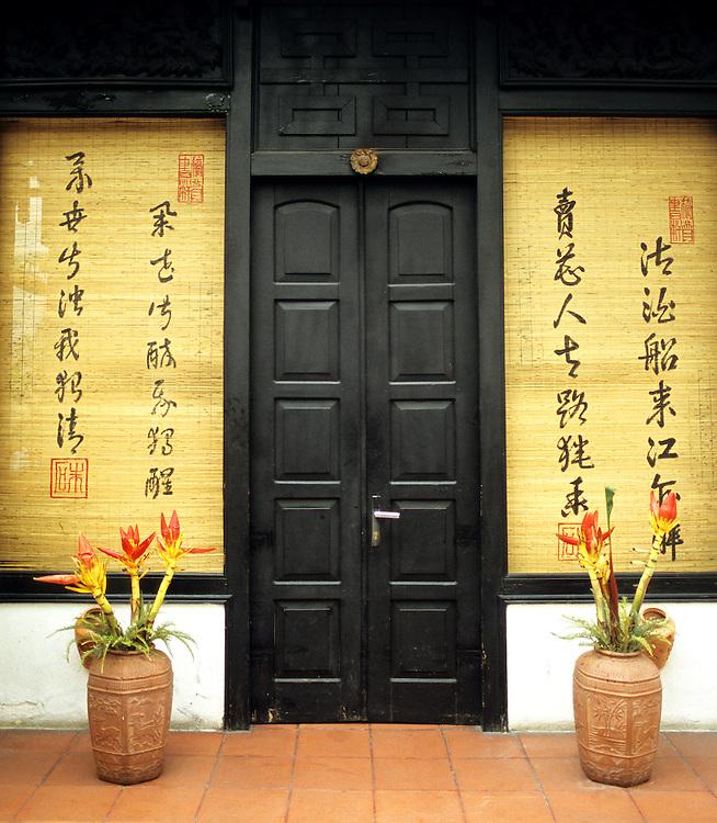Black Doors - Timber doorway in street frontage of Brothers Cafe in Nguyen Thai Hoc St, Hanoi Old Quarter, Viet Nam