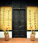 Black Doors - Timber doorway in street frontage of Brothers Cafe in Nguyen Thai Hoc St, Hanoi Old Quarter, Viet Nam