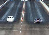Feb 21, 2015; Chandler, AZ, USA; NHRA pro stock driver Vincent Nobile (right) races alongside Joey Grose during qualifying for the Carquest Nationals at Wild Horse Pass Motorsports Park. Mandatory Credit: Mark J. Rebilas-