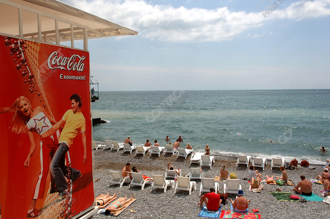 Sunbathers relax of the shores of the Black Sea. Yalta, Republic of Crimea, May 27, 2006. .