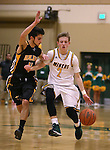 Manogue's Collin Bernard drives past Galena defender Noah Peck at Manogue High School in Reno, Nev., on Tuesday, Feb. 11, 2014. Manogue won 66-59.<br /> Photo by Cathleen Allison