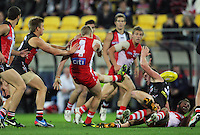 Saints half-forward Daniel Hennebery gets a kick away during Australian Rules Football ANZAC Day match between St Kilda Saints and Sydney Swans at Westpac Stadium, Wellington, New Zealand on Thursday, 24 May 2013. Photo: Dave Lintott / lintottphoto.co.nz