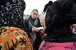 Sabeen Abdulsater, project officer for the Bekaa Valley for International Orthodox Christian Charities, interviews women refugees from Syria in the village of Jeb Jennine, Lebanon.