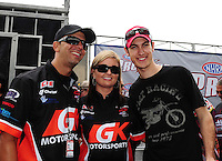 Apr. 15, 2012; Concord, NC, USA: NASCAR driver Joey Logano (right) with pro stock driver Erica Enders (center) and Richie Stevens during the Four Wide Nationals at zMax Dragway. Mandatory Credit: Mark J. Rebilas-