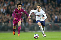 Leroy Sane of Manchester City and Erik Lamela of Tottenham Hotspur during Tottenham Hotspur vs Manchester City, Premier League Football at Wembley Stadium on 14th April 2018