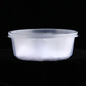 Clear plastic half-pint container for takeout foods, empty
