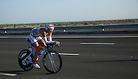 12 MAR 2011 - ABU DHABI, UAE - Julie Dibens makes her way to the Yas Marina Circuit for the first lap of the Formula 1 motor racing track during the Abu Dhabi International Triathlon .(PHOTO (C) NIGEL FARROW)