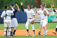 16 May 2010:  FIU's players, Garrett Wittels (10, center), celebrate after the FIU Golden Panthers defeated the University of South Alabama Jaguars, 5-0, at University Park Stadium in Miami, Florida.  With his single in the fourth inning, Wittels tied Roger Schmuck (Arizona State, 1971) for third on the NCAA all-time consecutive hitting streak list.
