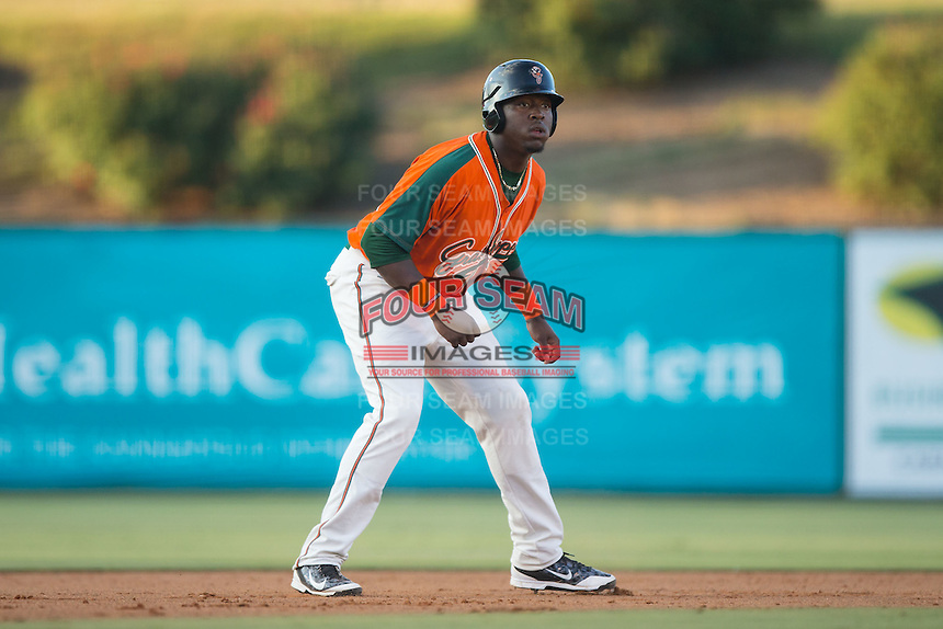 K.J. Woods (32) of the Greensboro Grasshoppers takes his lead off of second base against the Kannapolis Intimidators at CMC-Northeast Stadium on June 11, 2015 in Kannapolis, North Carolina.  The Intimidators defeated the Grasshoppers 7-6.  (Brian Westerholt/Four Seam Images)