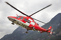 "Switzerland. Canton Ticino. Lodrino Air Base Airport (LSML). Intermediate landing for a Rega Agusta AW109 SP Grand ""Da Vinci"" helicopter on a rescue mission. All Rega helicopters carry a crew of three: a pilot, an emergency physician, and a paramedic who is also trained to assist the pilot for radio communication, navigation, terrain/object avoidance, and winch operations. The name Rega was created by combining letters from the name ""Swiss Air Rescue Guard"" as it was written in German (Schweizerische Rettungsflugwacht), French (Garde Aérienne Suisse de Sauvetage), and Italian (Guardia Aerea Svizzera di Soccorso). Rega is a private, non-profit air rescue service that provides emergency medical assistance in Switzerland. Rega mainly assists with mountain rescues, though it will also operate in other terrains when needed, most notably during life-threatening emergencies. As a non-profit foundation, Rega does not receive financial assistance from any government. People in distress can call for a helicopter rescue directly (phone number 1414). The AgustaWestland AW109 is a lightweight, twin-engine, helicopter built by the Italian manufacturer Leonardo S.p.A. (formerly AgustaWestland, Leonardo-Finmeccanica and Finmeccanica). Leonardo S.p.A is an Italian global high-tech company and one of the key players in aerospace. In close collaboration with the manufacturer, the Da Vinci has been specially designed to cater for Rega's particular requirements as regards carrying out operations in the mountains. It optimally fulfills the high demands made of it in terms of flying characteristics, emergency medical equipment and maintenance. Safety, performance and space have been increased, and maintenance and noise emissions reduced. 9.09.2017 © 2017 Didier Ruef"