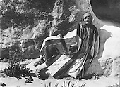 Portrait of Bedouin man, from the area of Petra, Trans-Jordan, wearing a traditional coat.