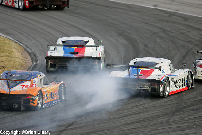 The winning Porsche Riley locks up its brakes as it races intot aturn during the Rolex 24 at Daytona , Daytona International Speedway, Daytona Beach, FL, January 2009.  )Photo by Brian Cleary)