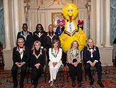 The recipients of the 42nd Annual Kennedy Center Honors pose for a group photo following a dinner at the United States Department of State in Washington, D.C. on Saturday, December 7, 2019.  From left to right back row: from the band Earth, Wind & Fire, singer Philip Bailey, bassist Verdine White, and percussionist Ralph Johnson; from Sesame Street, Abby, Big Bird, and Elmo.  Front row, left to right: Michael Tilson Thomas; Linda Ronstadt; Sally Field; Sesame street founders Joan Ganz Cooney and Dr. Lloyd Morrisett.  The 2019 honorees are: Earth, Wind & Fire, Sally Field, Linda Ronstadt, Sesame Street, and Michael Tilson Thomas.<br /> Credit: Ron Sachs / Pool via CNP