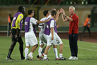 The United States' coach Thomas Rongen congratulates his team as they come off the field after their win against Cameroon 4-1 during the FIFA Under 20 World Cup Group C Match between the United States and Cameroon at the Mubarak Stadium on September 29, 2009 in Suez, Egypt.