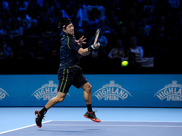 Kei Nishikori in action during his victory over Tomas Berdych in their Stan Smith Group match today - Kei Nishikori def Tomas Berdych 7-5, 3-6, 6-3<br /> <br /> Photographer Ashley Western/CameraSport<br /> <br /> International Tennis - Barclays ATP World Tour Finals - O2 Arena - London - Day 3 - Tuesday 17th November 2015<br /> <br /> &copy; CameraSport - 43 Linden Ave. Countesthorpe. Leicester. England. LE8 5PG - Tel: +44 (0) 116 277 4147 - admin@camerasport.com - www.camerasport.com