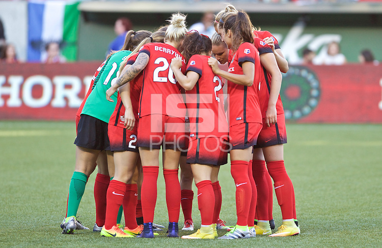 Portland, Oregon - Saturday July 2, 2016: The Thorns huddle up during a regular season National Women's Soccer League (NWSL) match at Providence Park.