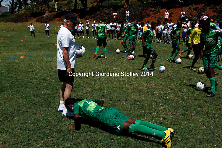 DURBAN - 26 January 2014 - Youths from AmaZulu's under 17 squad are the guinea pigs for a coaching course held by Dutch soccer coach Foppe De Haan (white tshirt and cap) for over a 100 local coaches at Durban's Northwood School, including this youngster who had to do 10 push ups for losing sight of the ball. Picture: Allied Picture Press/APP