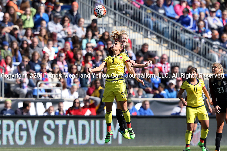 10 April 2016: Samantha Mewis (USA) (behind) heads the ball over Isabella Echeverri (COL) (5). The United States Women's National Team played the Colombia Women's National Team at Talen Energy Stadium in Chester, Pennsylvania in an women's international friendly soccer game. The U.S. won the match 3-0.