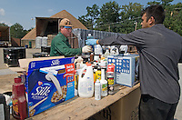 Hazardous waste workers sort through bottles and cans of leftover chemicals and cleaners, including items delivered in an organic soy milk box, dropped off at a hazardous waste disposal site in Westerville, Ohio. Homeowners were able to remove any hazardous waste from their homes to be properly recycled or disposed of instead of placing in their trash or pouring down the drain.<br />
