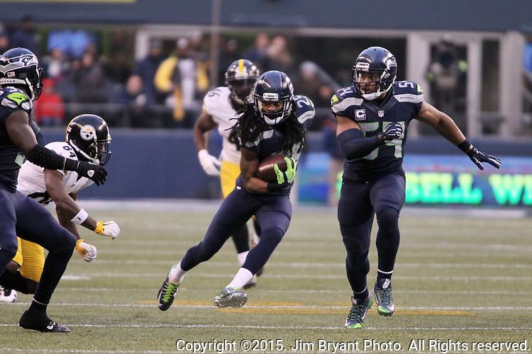 Seattle Seahawks cornerback Richard Sherman (25) returns an interception against the Pittsburgh Steelers at CenturyLink Field in Seattle, Washington on November 29, 2015.  The Seahawks beat the Steelers 39-30.      ©2015. Jim Bryant Photo. All Rights Reserved.