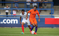 Mitchell Van Rooijen (Jong FC Utrecht) of Holland holds off Easah Suliman (Cheltenham Town on loan from Aston Villa) of England U19 during the International match between England U19 and Netherlands U19 at New Bucks Head, Telford, England on 1 September 2016. Photo by Andy Rowland.