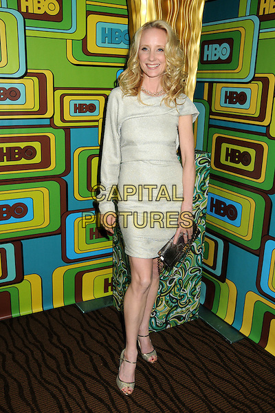 ANNE HECHE.HBO 2011 Post Golden Globe Awards Party held at The Beverly Hilton Hotel, Beverly Hills, California, USA..January 16th, 2011.full length beige dress one sleeve  silver clutch bag .CAP/ADM/BP.©Byron Purvis/AdMedia/Capital Pictures.