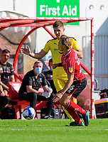 Lincoln City's Harry Anderson is fouled by Oxford United's Josh Ruffels<br /> <br /> Photographer Chris Vaughan/CameraSport<br /> <br /> The EFL Sky Bet League One - Saturday 12th September 2020 - Lincoln City v Oxford United - LNER Stadium - Lincoln<br /> <br /> World Copyright © 2020 CameraSport. All rights reserved. 43 Linden Ave. Countesthorpe. Leicester. England. LE8 5PG - Tel: +44 (0) 116 277 4147 - admin@camerasport.com - www.camerasport.com - Lincoln City v Oxford United