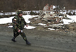 (Tuzla, Bosnia, 02/07/02) Members of the Massachusetts Army National Guard maintain order in the aftermath of ethnic cleansing and prevent a resumption of violence that ravaged the former Yugoslav state by provide security for displaced residents returning to rebuild their shattered homes in Northern Bosnia on Thursday, February 07, 2002. Staff photo by Christopher Evans