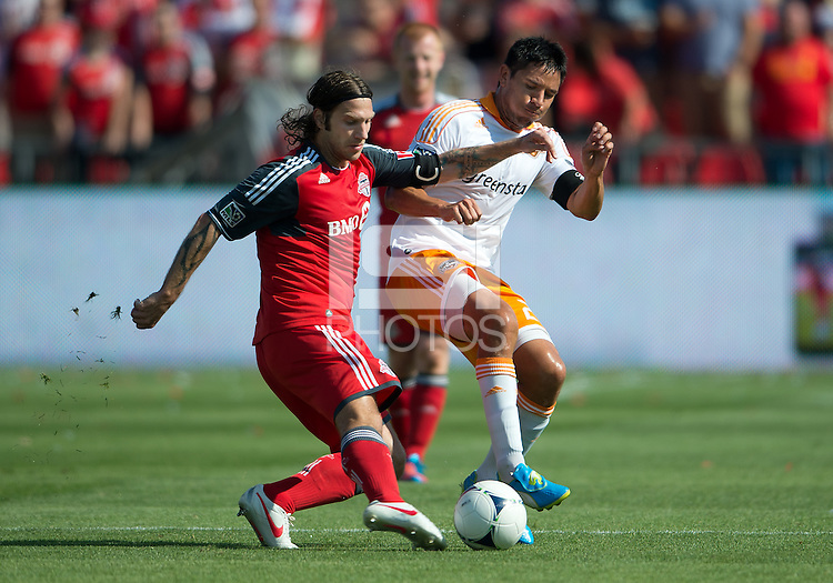 July 28, 2012: Toronto FC midfielder Torsten Frings #22 and Houston Dynamo forward Brian Ching #25 in action during a game between Toronto FC and the Houston Dynamo at BMO Field in Toronto, Ontario Canada..The Houston Dynamo won 2-0.
