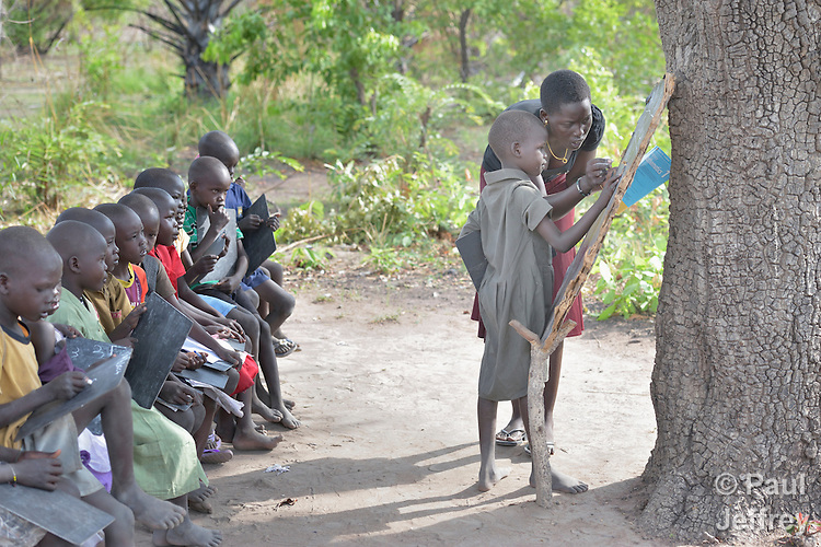Elizabeth Ayen teaches students under a tree at the Loreto Primary School in Rumbek, South Sudan. The school is run by the Institute for the Blessed Virgin Mary--the Loreto Sisters--of Ireland. Ayen is a graduate of the Loreto Secondary School in the same location, and plans to become a nurse.