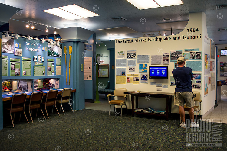 A visitor examines one of the many exhibits at the Pacific Tsunami Museum in downtown Hilo, Big Island of Hawai'i.
