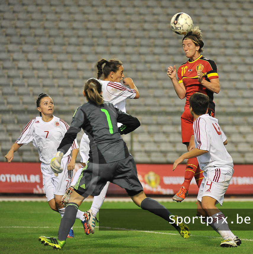 20130921 - BRUSSELS , BELGIUM : Belgian Aline Zeler pictured with the header above the Albanian defence during the female soccer match between Belgium and Albania , on the first matchday in group 5 of the UEFA qualifying round to the FIFA Women World Cup in Canada 2015 at the Koning Boudewijn Stadion , Brussels . Saturday 21th September 2013. PHOTO DAVID CATRY