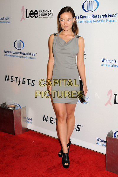 OLIVIA WILDE.EIF's Women's Cancer Research Fund Benefit held at the Beverly Wilshire Hotel, Beverly Hills, California, USA..January 27th, 2010.full length sleeveless dress grey gray clutch bag heels black ankle cut out platform peep toe perforated .CAP/ADM/BP.©Byron Purvis/AdMedia/Capital Pictures.