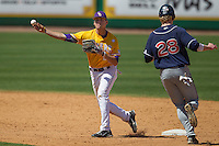 LSU Tigers second baseman JaCoby Jones #23 turns a double play against the Auburn Tigers in the NCAA baseball game on March 24, 2013 at Alex Box Stadium in Baton Rouge, Louisiana. LSU defeated Auburn 5-1. (Andrew Woolley/Four Seam Images).