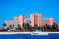 Boat in Nassau harbour on the island of New Providence in the Bahamas with Atlantis Resort in the background