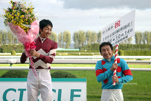 (L-R) Yutaka Take, Norihiro Yokoyama,<br /> OCTOBER 14, 2014 - Horse Racing :<br /> Jockey Yutaka Take celebrates his 18648th JRA race riding record with Norihiro Yokoyama after the Kyoto 12R at Kyoto Racecourse in Kyoto, Japan. (Photo by Eiichi Yamane/AFLO)